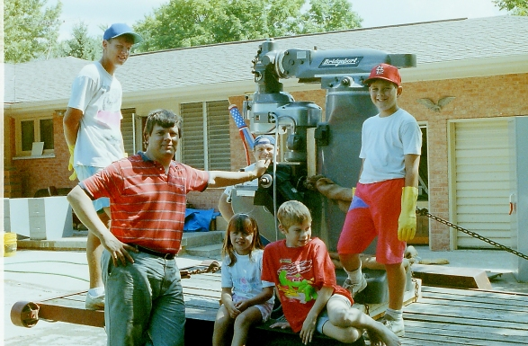 The Burns family posing with a new lathe.