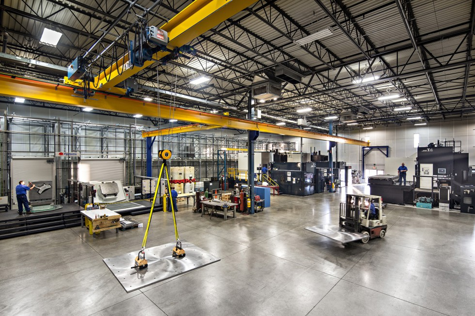 A wide shot of the Patriot Machine shop floor, showing the installation of a new machining center.