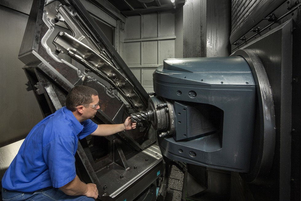 A Patriot Machine associate servicing a six-axis machining center.