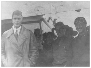 An old, black and white photograph of an aviation squadron, featuring Charles Lindbergh and David S. Kemp, Judy Burns' grandfather.