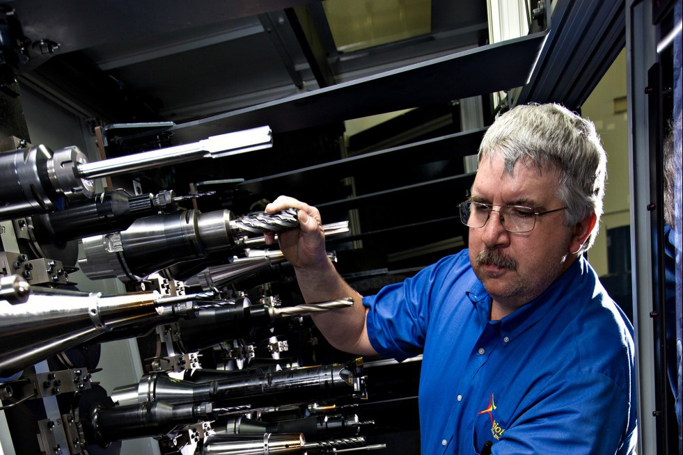 A Patriot Machine associate carefully choosing the spindles for use in a machining cell.